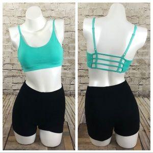 NWOT Teal cut out back sports bra size medium